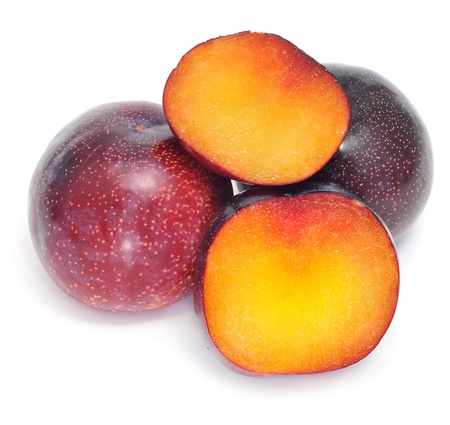 a pile of plums on a white background photo
