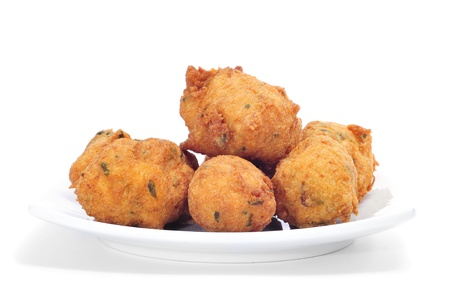 fritters: a plate with some cod fritters on a white background
