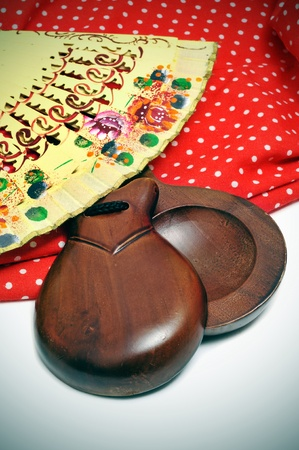 castanets, fan and flamenco dress typical of Spain photo