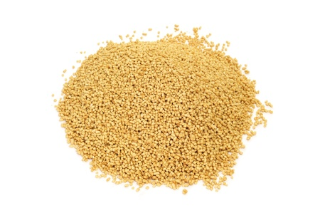 a pile of soy lecithin granules on a white background photo