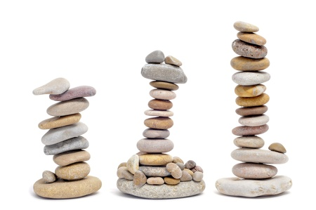 some piles of zen stones on a white background Stock Photo - 9421722