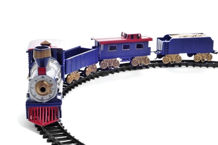 miniature people: closeup of a toy train on a white background