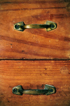 closeup of ancient wooden drawers photo