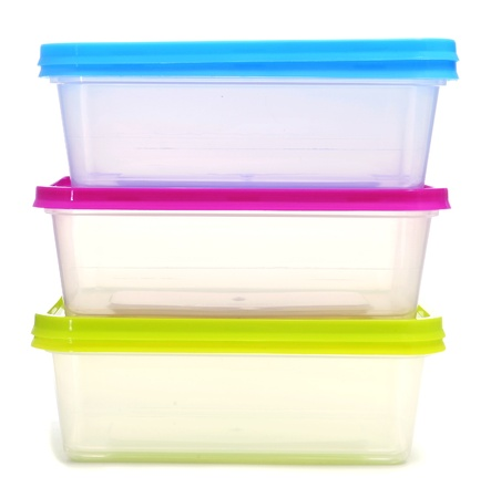 plastic container: a pile of plastic containers on a white background