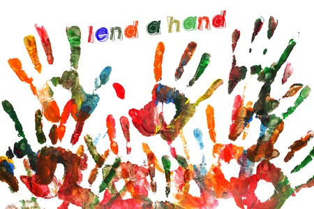 lend a hand written on a background full of handprints of different colors Stock Photo - 9482416