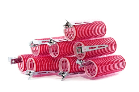 some red hair rollers on a white background Stock Photo - 9527372