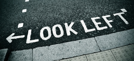 look left sign painted on the road photo