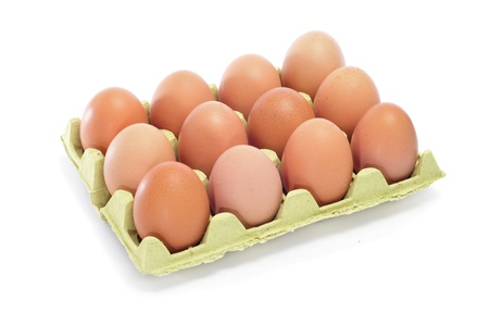 12: brown eggs in an egg carton on a white background