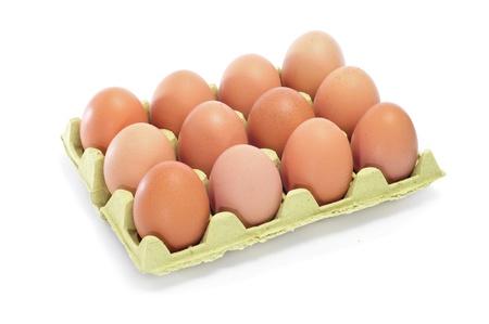 dozen: brown eggs in an egg carton on a white background