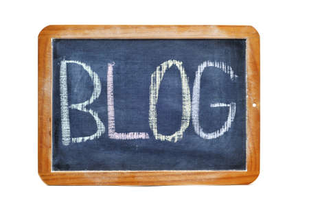 word blog written with chalk on a blackboard Stock Photo - 9527627