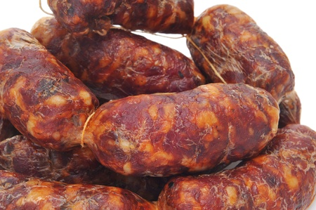 embutido: closeup of red spanish chorizos on a white background Stock Photo