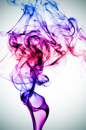 smoke of different colors on a vignetted background photo