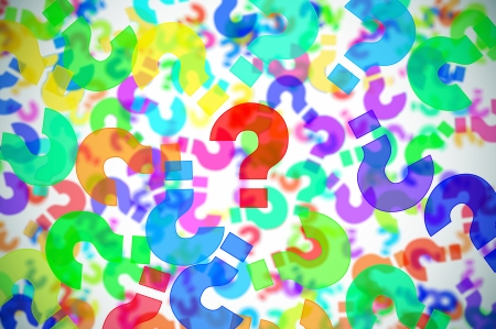 quiz: question marks of different colors drawn on a white background Stock Photo