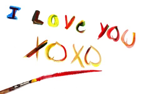 xoxo: I love you and XOXO written with paint of different colors on a white background Stock Photo