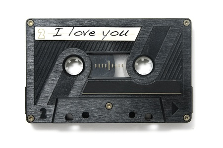 tape recorder: I love you written in the label of a tape on a white background