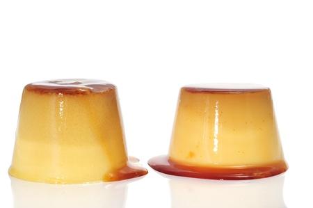 some creme caramel on a white background photo