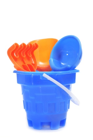 a blue castle bucket with shovels and rake on a white background photo