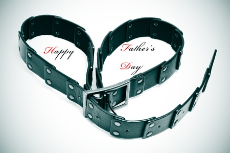 a belt forming a heart and the sentence happy fathers day Stock Photo - 9594161