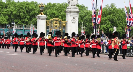 buckingham: London, United Kingdom - May 6, 2011: Coldstream Guards in front of Buckingham Palace in London, UK. The 7 company is involved in the Changing of the Guard every day at 11.30 AM.