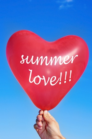 someone holding a heart-shaped balloon with sentence summer love written on it Stock Photo - 9635037