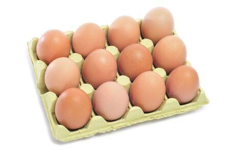 a dozen of brown eggs in a egg carton photo