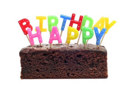 sentence: a birthday cake with candles forming the sentence happy birthday on a white background Stock Photo