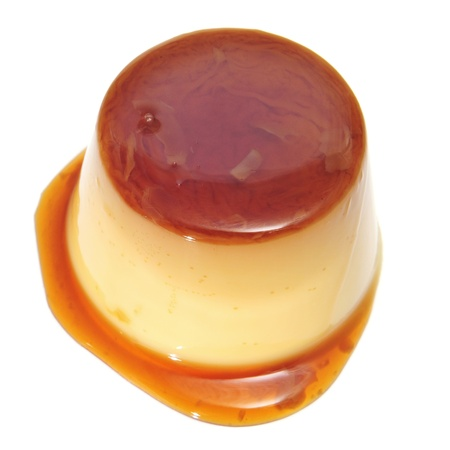 vanilla pudding: a creme caramel on a white background