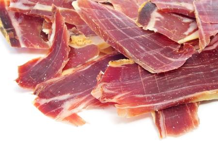 closeup of a pile of spanish serrano ham photo