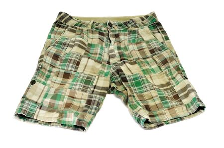 a pair of green shorts on a white background