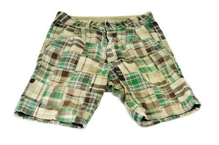 pantalones cortos: un par de pantalones cortos verdes sobre un fondo blanco