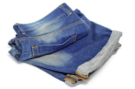 hem: a pair of denim shorts on a white background