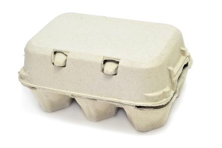 carton: eggs in an egg carton on a white background