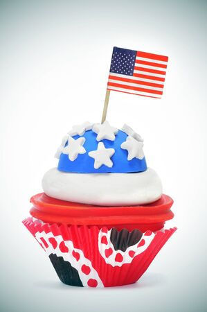 a cupcake decorated with the colors and stars of United States flag photo