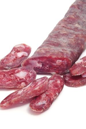 embutido: fuet, spanish salami, on a white background