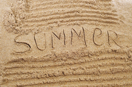 word summer written in the sand of a beach Stock Photo - 9728438