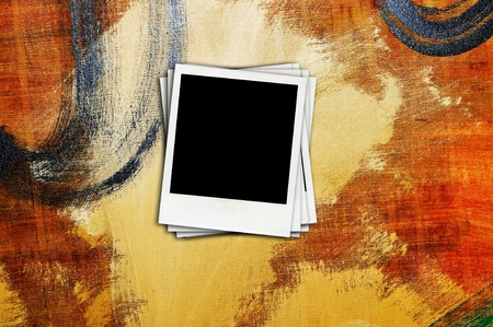 some blank retro photo frames on a colorful background photo