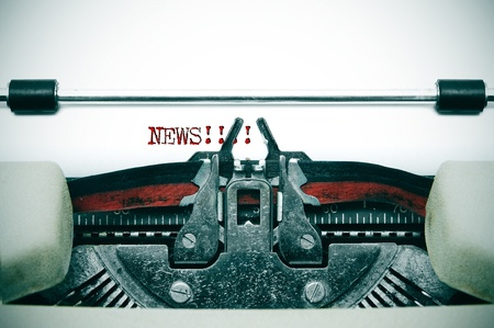 journalist: word news written in an ancient typewriter