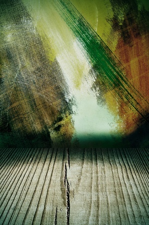 closeup of a dark room with old wood floor and colorful wall photo