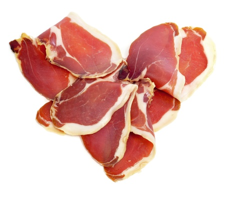 a pile of spanish serrano ham forming a heart Stock Photo