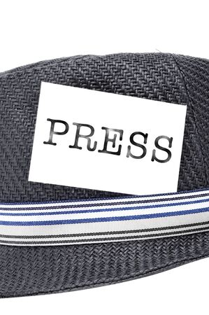 a vintage hat with a label with the word press photo