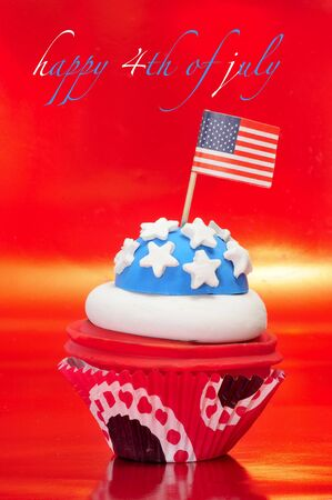 Happy 4th of july and a cupcake decorated with the colors and stars of United States flag photo