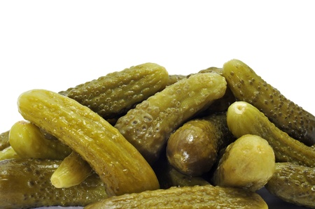 marinated gherkins: a pile of pickles on a white background