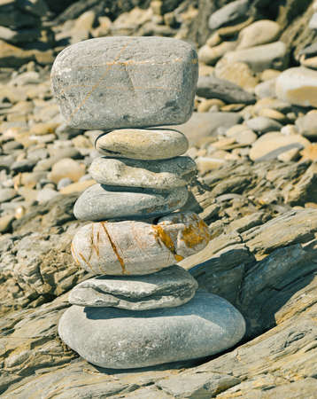 shingle beach: a strack of zen stones on a shingle beach Stock Photo
