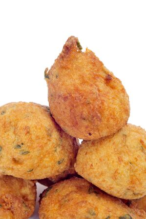 a few cod fritters on a white background photo