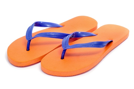 flip flops: a pair of orange flip-flops on a white background