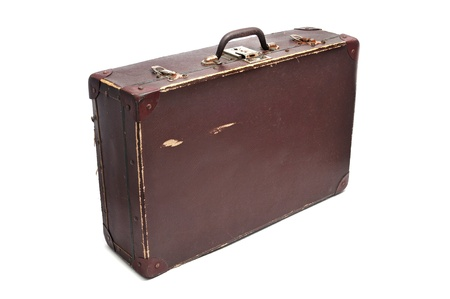 migrate: an old brown suitcase on a white background
