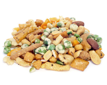 a lot of mixed nuts and salty crackers on a white background Stock Photo - 9889138