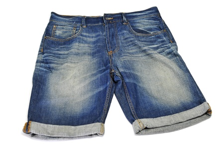 a pair of denim shorts on a white background photo