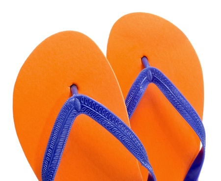flop: a pair of orange flip-flops on a white background