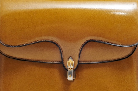 closeup of a brown vintage leather purse photo